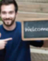man-holding-welcome-sign.jpg