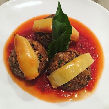 Pecan and Portobello 'Neatballs' served in Marinara on topped with Smoked Gouda