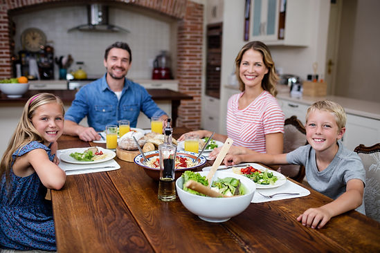 Happy family having meal in kitchen at home.jpg
