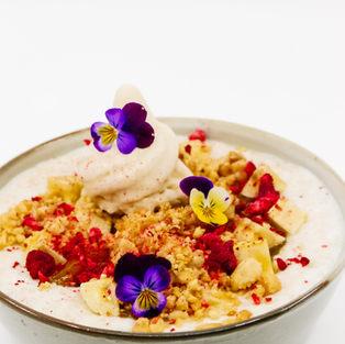 Coconut Porridge, Sticky Passionfruit & Mango Jam, Banana, Roasted Macadamias, Raspberries, Coconut Soft Serve + Maple Syrup