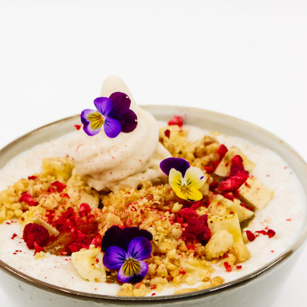 Coconut Porridge, Sticky Passionfruit & Mango Jam, Banana, Roasted Macadamias, Raspberries, Coconut Soft Serve + Maple Syrup