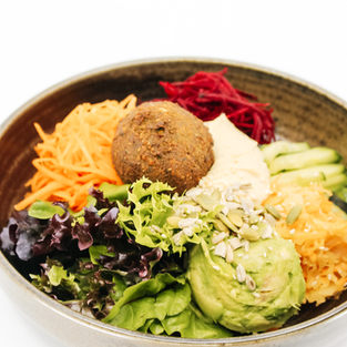 Falafel Bowl w/ Hummus, Beetroot, Shredded Carrot, Cucumber, Avocado, Fermented Slaw, Lettuce, Tahini & Maple Dressing + Seeds