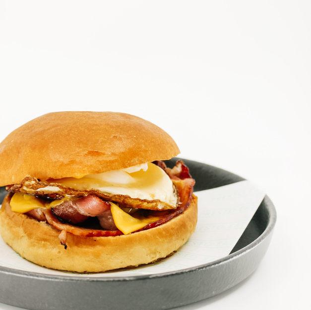 Egg & Bacon Burger, Cheddar Cheese In A Soft Brioche Bun, tomato relish
