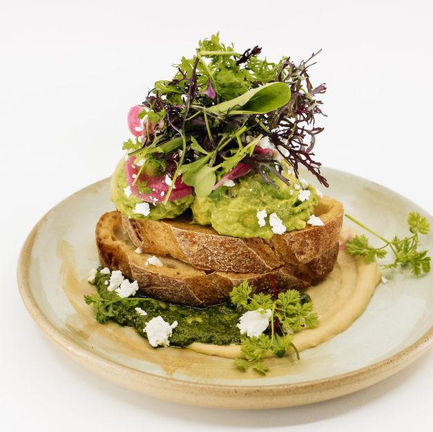 Avocado Smash On Sourdough, Hummus, Basil & Walnut Pesto, Crumbled Feta, Pickled Onion + Herb Salad
