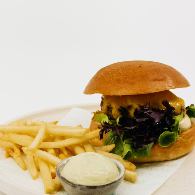 Truffle Cheeseburger w/ Beef Patty, Melted Cheese, Truffle Mayonnaise, Lettuce + French Fries and Dipping Sauce