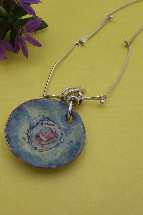 Handmade enameled pendant with sterling silver chain.