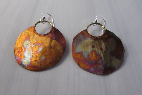 Hand fabricated copper patina and sterling silver earrings.