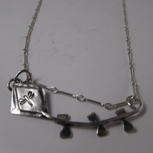 Hand fabricated sterling kite necklace.
