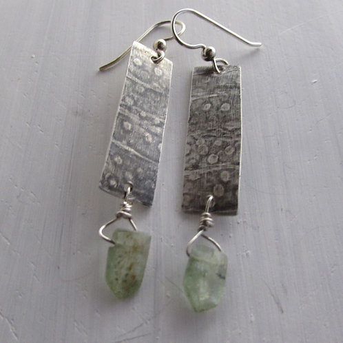 Hand fabricated sterling silver with green kyanite stones.