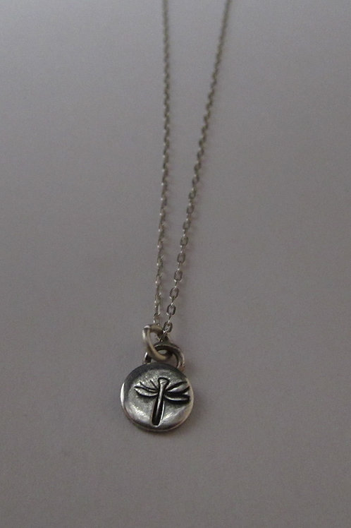 Handcrafted sterling silver dragonfly pendant on a 18 inch chain.