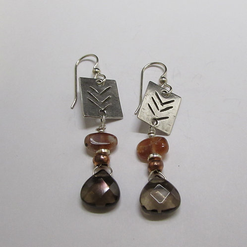 Handcrafted sterling silver earrings with smoky topaz and sunstone.
