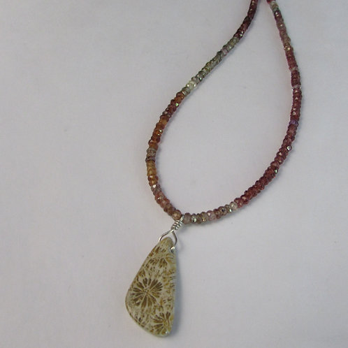 Handcrafted necklace with tourmaline beads and ocean fossil stone.