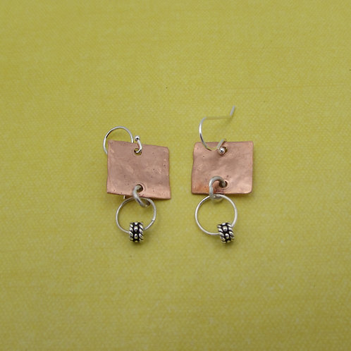 Sterling silver and copper earring.
