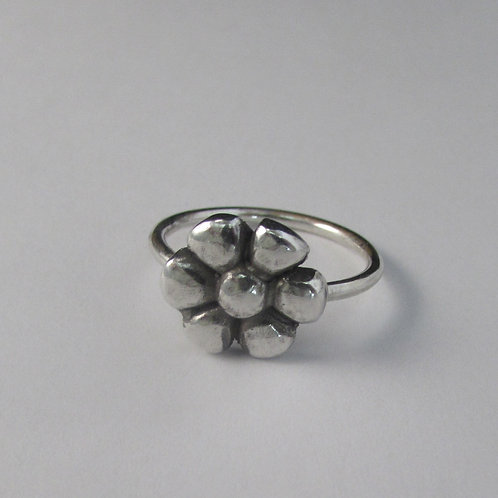 Handcrafted sterling silver flower ring.