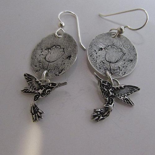 Hand fabricated sterling silver hummingbird earrings.