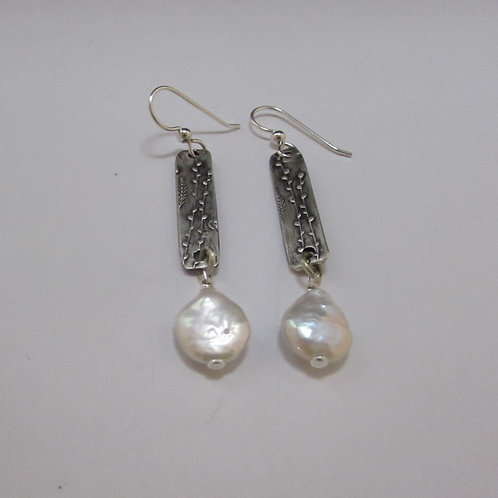 Handcrafted sterling silver pearl earrings.