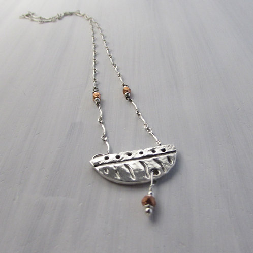 Hand fabricated sterling silver and copper necklace.