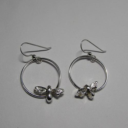 Handcrafted sterling silver bee earrings.