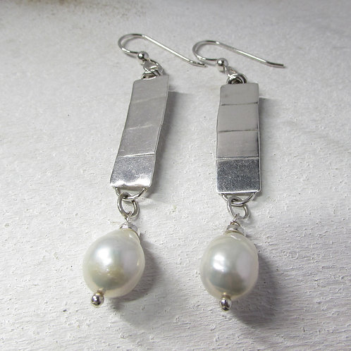 Handcrafted sterling silver earrings with pearl.