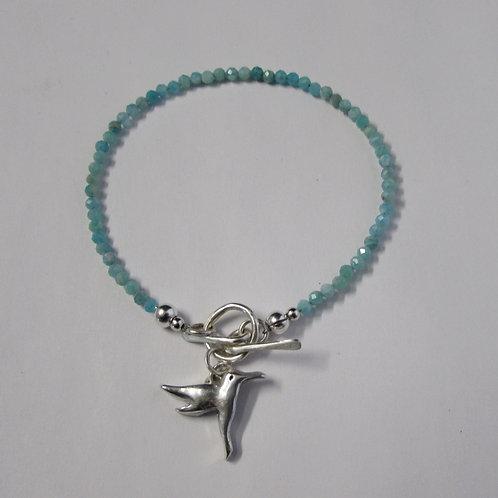 Handcrafted sterling silver hummingbird bracelet.