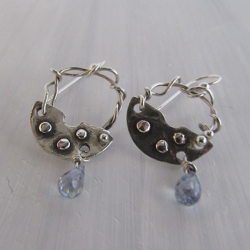 Hand fabricated sterling silver earrings with light blue quartz stones.