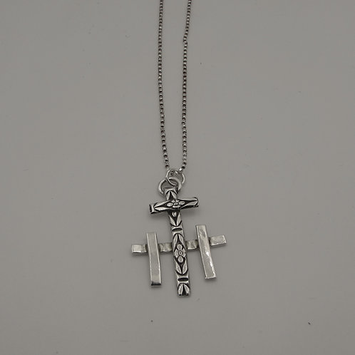 Handmade sterling silver three cross necklace.