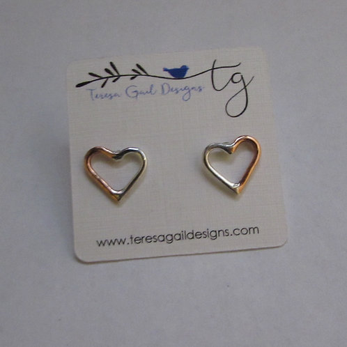 Handcrafted sterling silver and copper heart earrings.