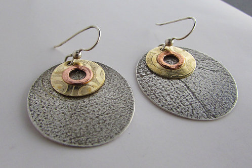 Hand fabricated sterling silver earrings with copper and bronze discs.