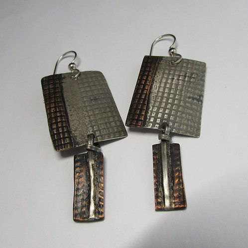Handcrafted sterling silver and copper earrings.