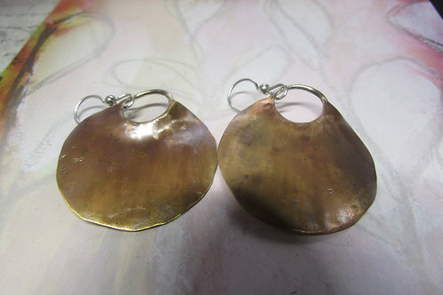 Hand fabricated bronze and sterling silver earrings.