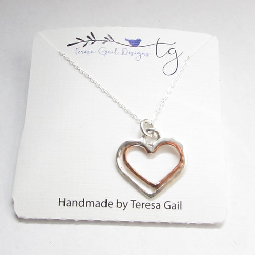 Handcrafted sterling silver and copper heart necklace.
