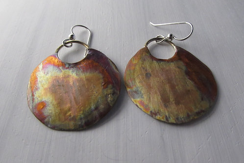 Hand fabricated copper and sterling silver earrings.