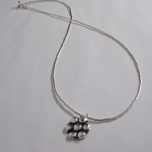 Handcrafted sterling silver flower necklace.
