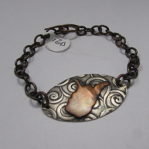 Handcrafted sterling silver and copper West Virginia bracelet.