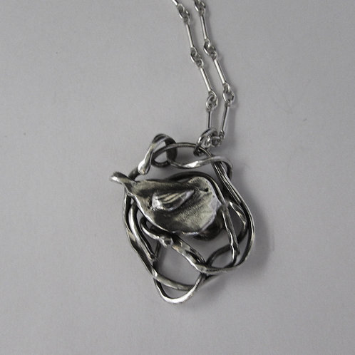 Handcrafted sterling silver bird nest necklace.