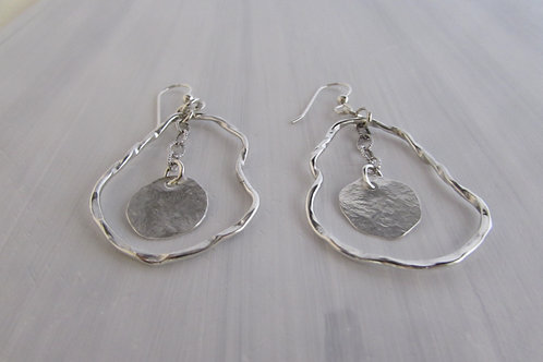 Hand fabricated sterling silver earrings.