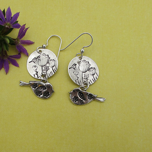 Beautiful handmade sterling silver bird and floral earrings.