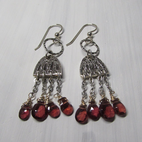 Hand fabricated sterling silver earrings with garnets.