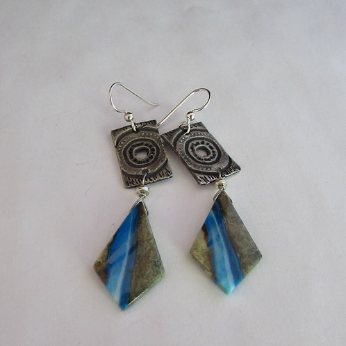 Handcrafted sterling silver earrings with opal stones.