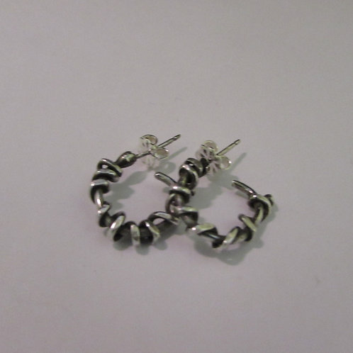 Handcrafted sterling silver post earrings.