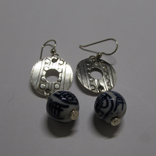 Handcrafted sterling earrings with blue painted beads.