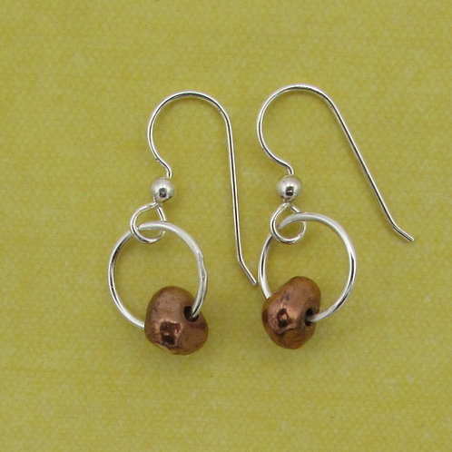 Handmade sterling silver earrings with copper bead.