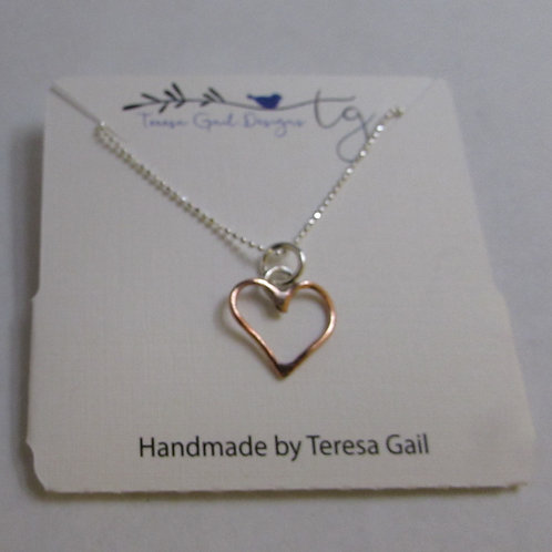 Handcrafted copper and sterling silver heart.