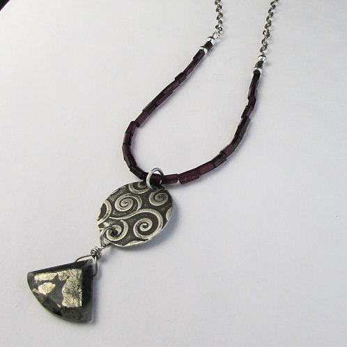 Handcrafted sterling silver necklace with garnet beads and marcasite stone.