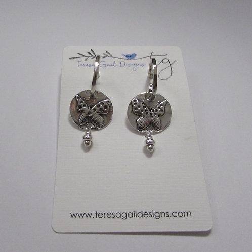 Handcrafted sterling silver butterfly earrings.