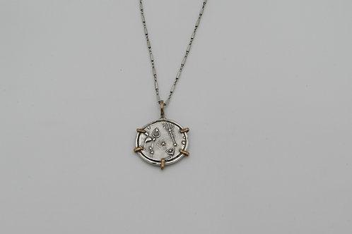 Handmade sterling silver botanical pendant.