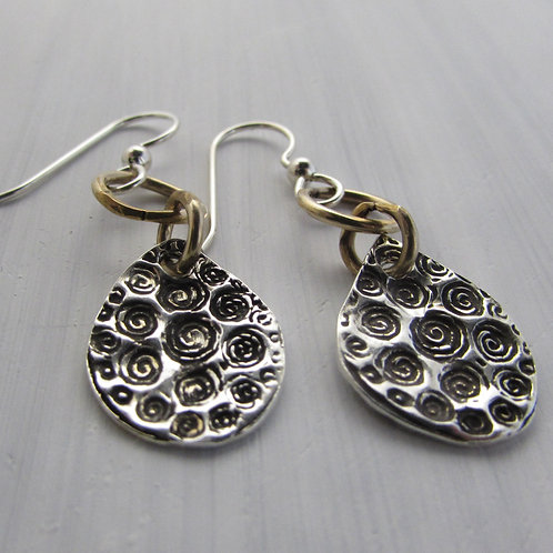 Hand fabricated sterling silver earrings with 14kt gold filled circles.
