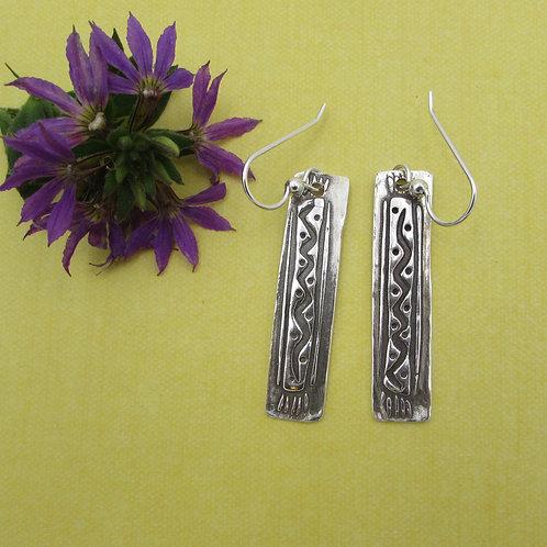 Handmade one-of-kind sterling silver earrings.