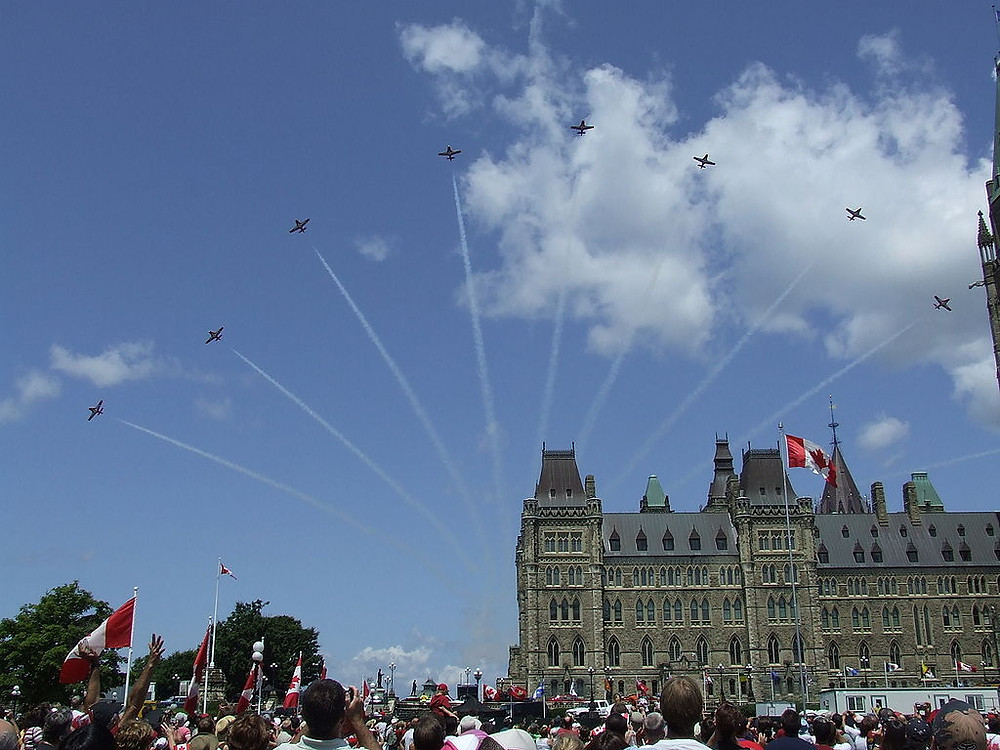 By Naimi Grondin - originally posted to Flickr as Canada Day 2008 // Snowbirds over Parliament, CC BY-SA 2.0, https://commons.wikimedia.org/w/index.php?curid=6408246