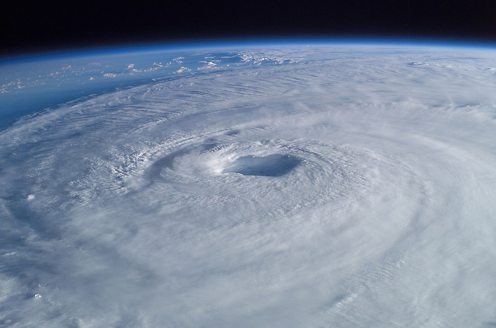 Hurricane Isabel (2003) as seen from orbit during Expedition 7 of the International Space Station. The eye, eyewall, and surrounding rainbands, characteristics of tropical cyclones in the narrow sense, are clearly visible in this view from space.